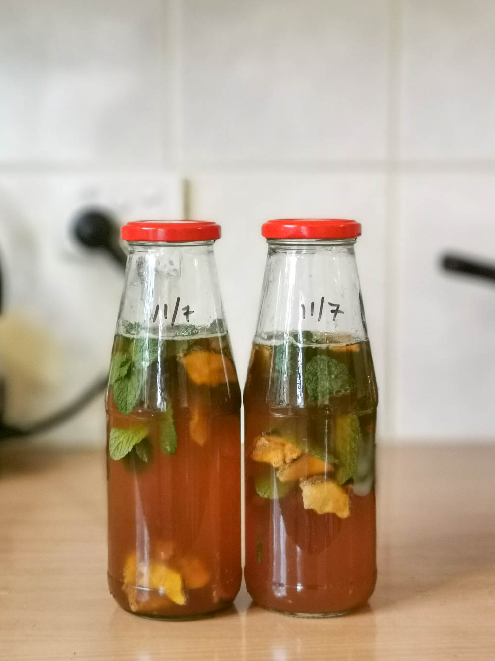 Mint and galangal kombucha brewing.