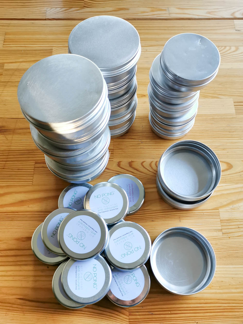 Recycled tins, ready for filling.