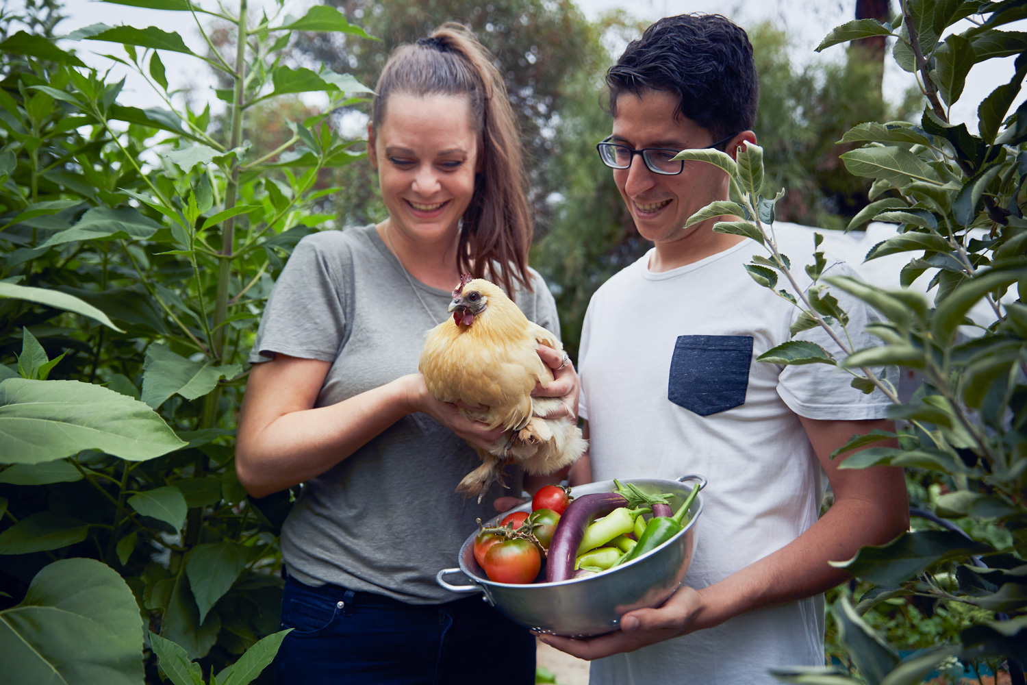 Koren Helbig and Carmelo Scavone with Esty the chicken