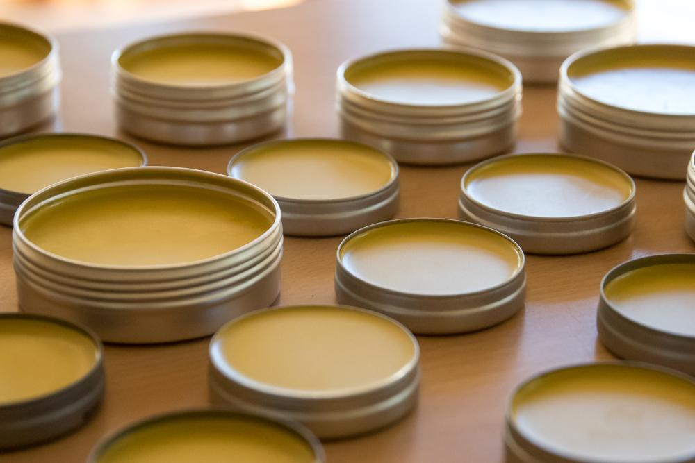 Calendula salve setting in recycled tins.